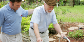 caregiver accompanying an old man